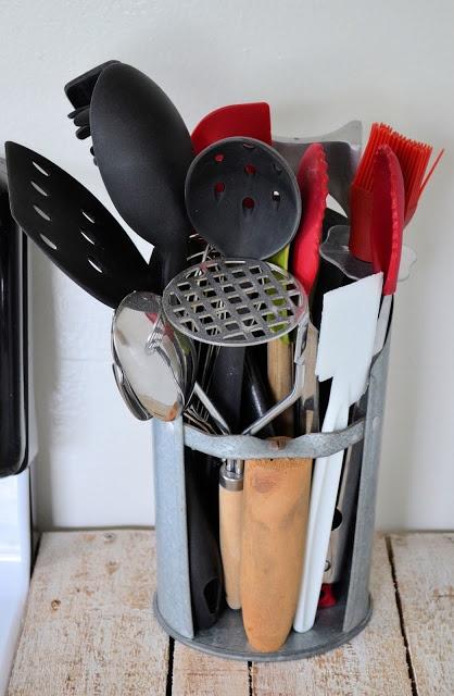 Grain scoop as a kitchen utensil holder.
