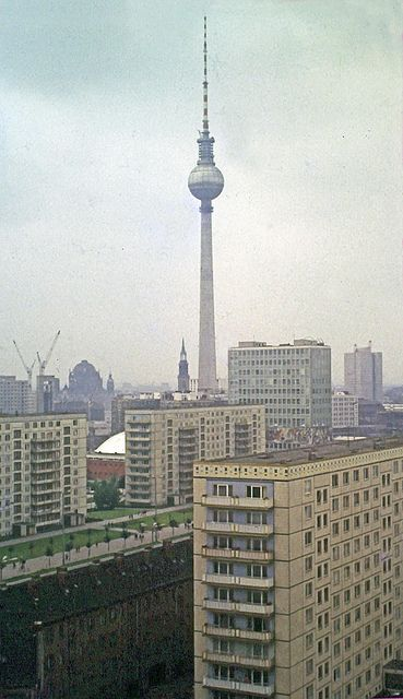 East Berlin Skyline    In the summer of 1969 when this photograph was taken, the Television Tower was almost complete. (It was opened on 3rd October).    The dome of Berlin Cathdedral can be seen, as well as the spire of St Mary's Chruch and, in the middle distance, the House of the Teachers and its Congress Hall also built in the 1960's.    The photograph was taken from the roof of the Interhotel Berolina (built 1961-3, demolished 1996)  von HJ in Ches via Flickr