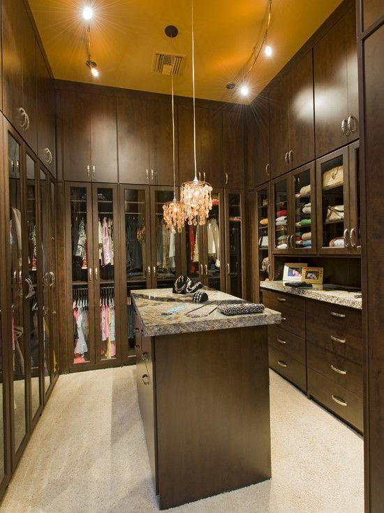 beautiful master closet with glass doors