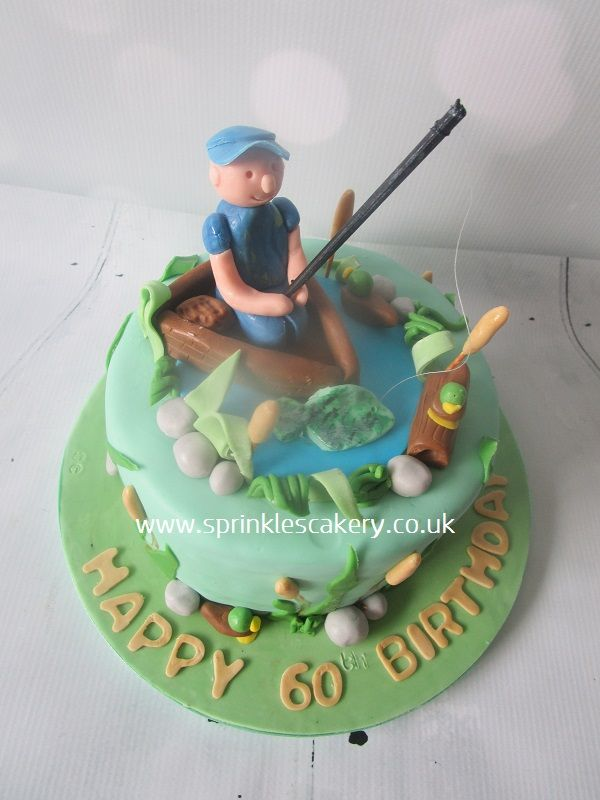 This fishing themed cake was for a 60th birthday celebration. The models were handcrafted from a mixture of fondant and edible modelling paste and were all edible, except for the fishing rod which was made from an painted skewer and cotton and pond weed stems (cocktail sticks)