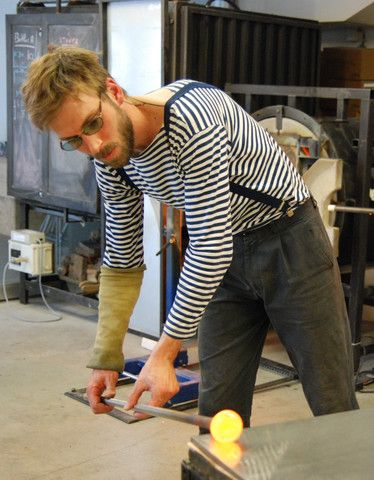 Damien discovered glass work by chance, in the Lofoten Islands in Norway, and decided to pursue it as a course of study.  He started by learning the basics of glassblowing at Engelshom Højskole College in Denmark, then .... (click to read more about Damien...)