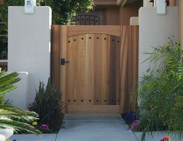 flattop wooden gate with clavos and cathedral arch traditional fencing orange county