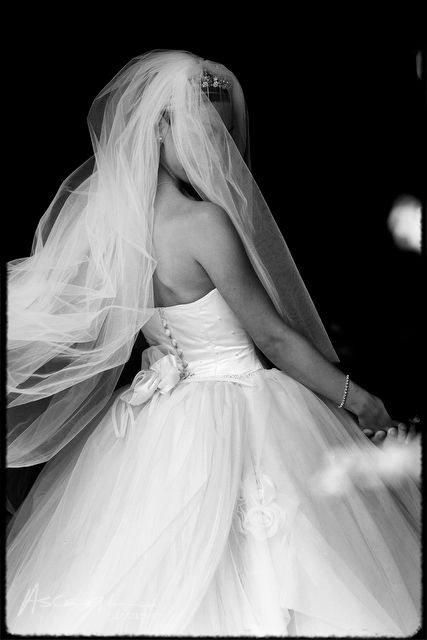 a back view of the bride as she enters a church for her wedding near Liverpool…