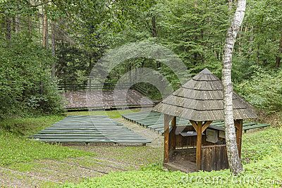 Small amphitheatre in the forest in open air museum in Nowy Sącz , Poland.