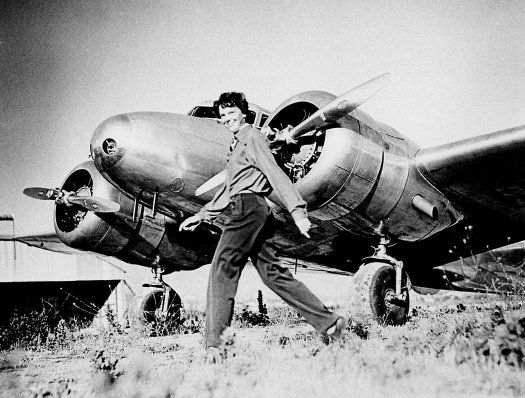 Amelia Earhart and Her Airplane Earhart with her custom-built Lockheed Electra 10E, built to her specifications, which she planned to fly around the world.