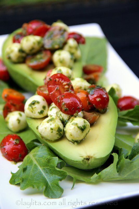 Avocados filled with tomato mozzarella caprese salad