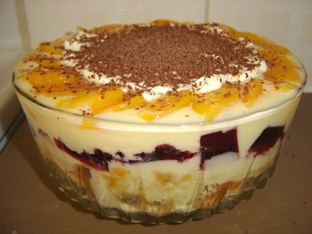 English Trifle.  It's the way my mum made it.  Sponge cake, custard, jelly, fruit salad, crushed nuts and cream.