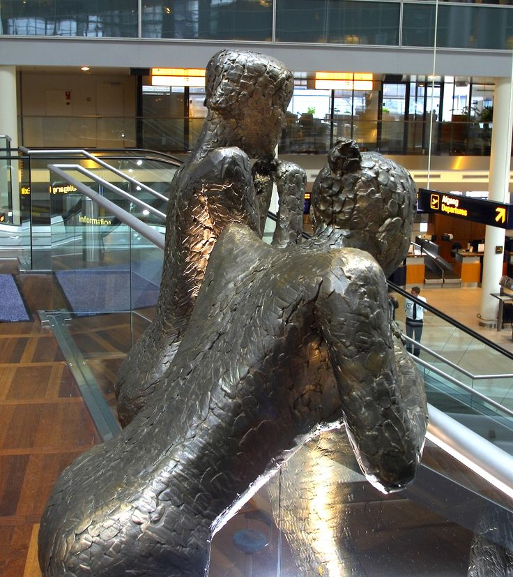 """These famous sculptures, """"The Girls at the Airport"""" by Hanne Warming, has been watching the passengers from the balcony in Terminal 3 since 1999.  The artist has drawn inspiration for the sculpture in Paris, where she saw two young girls leaning against a railing waiting with the spirited attitude, which is reflected in the artwork."""
