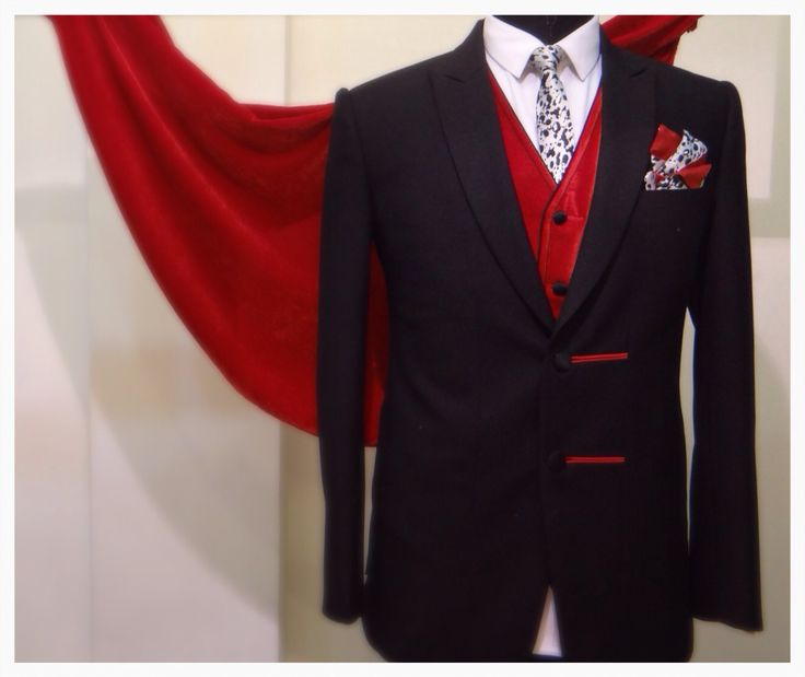 A dazzling red waist coat inside the black suit only at www.studiodhananjay.com
