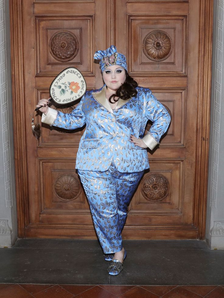 at Gucci's Resort 2018 show in Florence. Still, no one could compete with Beth Ditto. The rock star's lavender and gold leaf silk suit epitomized Alessandro Michele's look and made her the woman to watch in a room filled with stars. With a matching crystal headdress and bamboo fan, Ditto brought significant attitude to the front row, before she changed into a second Gucci look for her post-show set.