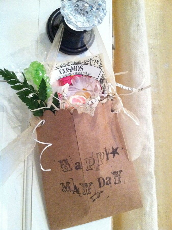 Paper Bag May Day Baskets — decorate paper bags for your May Day baskets. I especially like the addition of the flower seed packet. #diy #mayday #baskets