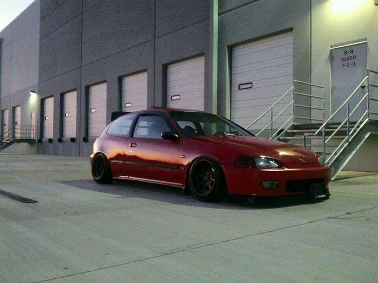 Red Honda Civic hatchback