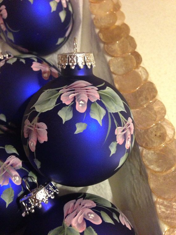 Hand painted Roses on round royal  blue ornament