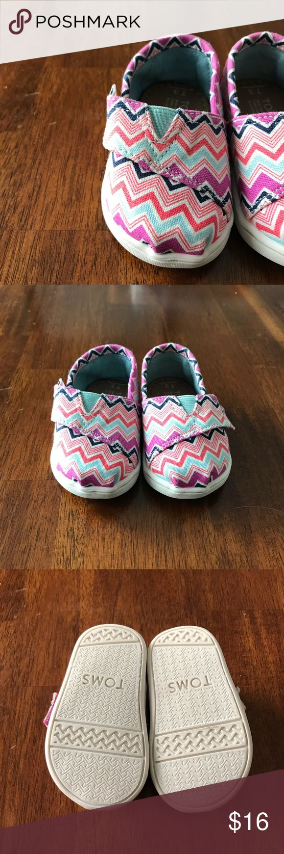 Chevron TOMS Size 3 Colorful chevron TOMS. Size 3. Excellent condition, maybe worn once. Canvas upper. Rubber soles. Velcro closure. Toms Shoes