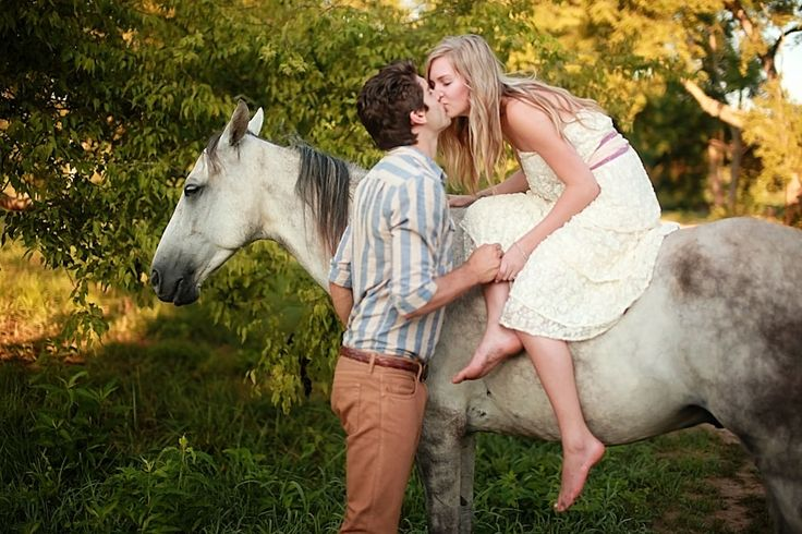 This boho chic couple jumped on horse back & made us swoon! Photograph by Amber Davis Photography http://www.storyboardwedding.com/an-early-morning-dream-engagement-session-filled-with-ponies-cool-water-love/