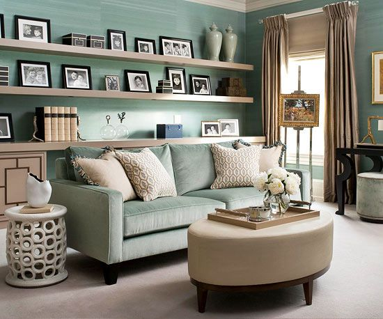 Minty green makes a splash as a plush velvet sofa, striated wallcovering, and slightly paler vases. Thoughtful arrangements of framed photos, neutral accent fabrics, and a few gilded touches provide interest at every level, while allowing mint to advance as the room's primary color./