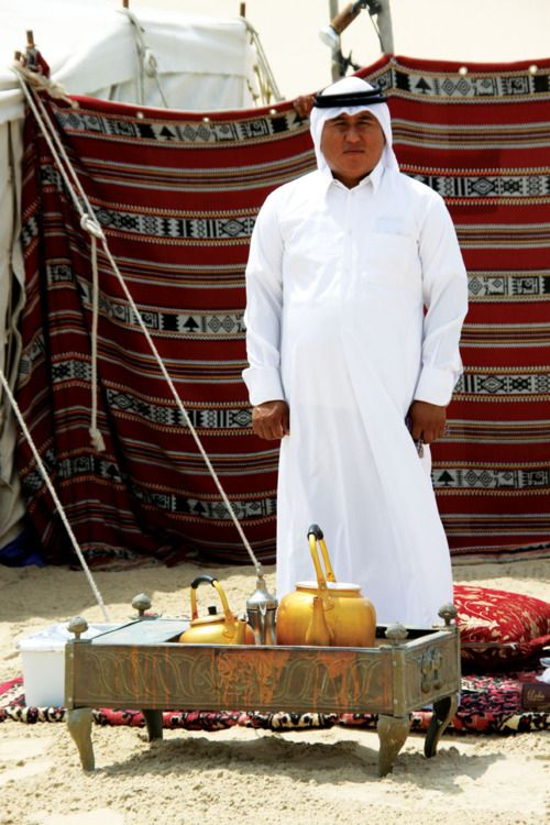 Tea time at a beduin camp in the desert outside of Doha, Qatar