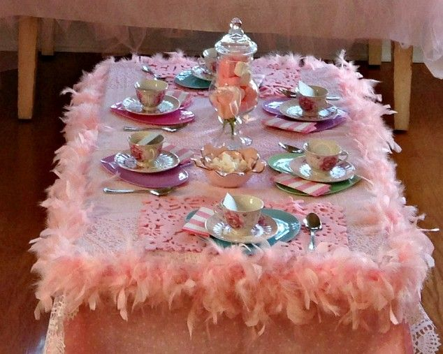 Adorable table - Simply pin pink boas around the pink tablecloth for the girliest tea party or princess party ever - Love it!
