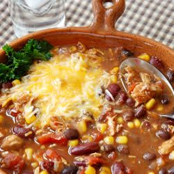 Slow Cooker Chicken Taco Soup - a hearty combination of beans, corn, tomatoes, and taco seasonings, slow cooked with shredded chicken:  385 calories, 17.6 g fat, 68 mg cholesterol per serving (without toppings)