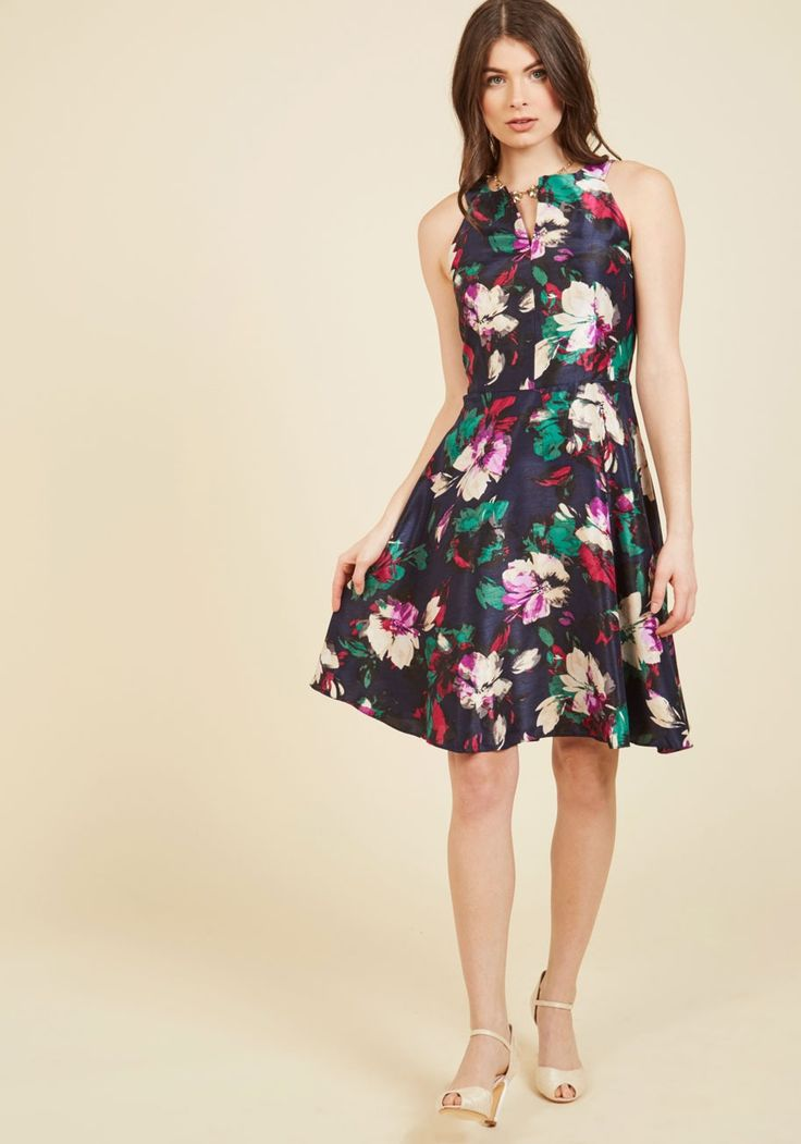 Woman of the Party People Floral Dress | Mod Retro Vintage Dresses | ModCloth.com  Ignite your bright attitude with this floral dress from Nine West! Bringing a silky glow to the party, the notched neckline, classic A-line silhouette, and beautiful artistic print of this navy blue frock will illuminate the room with smiles and compliments.