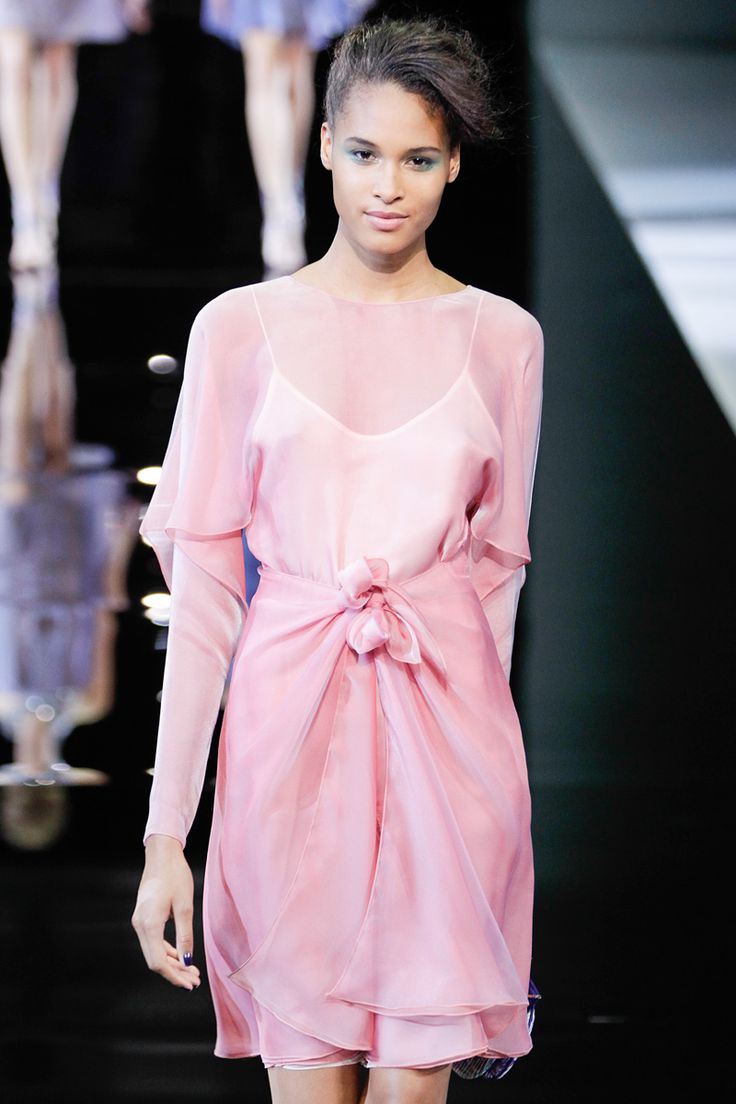 The pale pink hue, under-slip, and minimalism of this dress throwback to the 1990s. Deconstructionism, another 1990s trend, can also be seen in the ragged hem. Spring 2014 Giorgio Armani