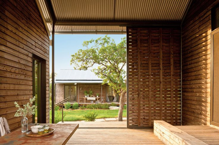 While modular homes appear to have little in common with traditional Southern vernacular architecture, Lake Flato found a way not only to marry the two concepts but also to celebrate the outdoors in the process.    The dogtrot has movable louvered doors that can be closed to block high winds or opened to connect to the central courtyard.