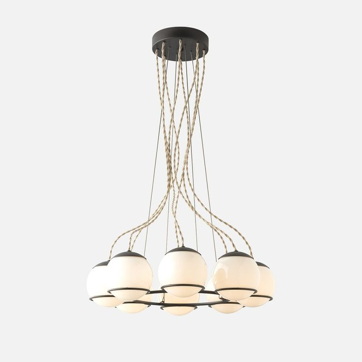 Our most statement-making chandelier, the Orbit 8 is awash in sophistication and scale. Featuring an updated minimalist canopy that highlights the richness and weight of its handcrafted brass material. Visually striking in any sized interior, each detail has been thoughtfully considered to create a thoroughly luxe and sculptural fixture. The Orbit 8 uses handcrafted materials that are custom built in our Portland factory to exacting specifications. A Schoolhouse Electric Original…