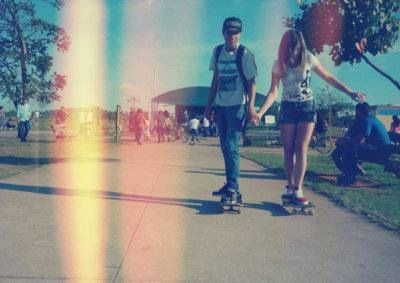 On wave board. smooth sidewalk. . . Even if she can't skate I'll hold her hand and make sure she doesn't fall.