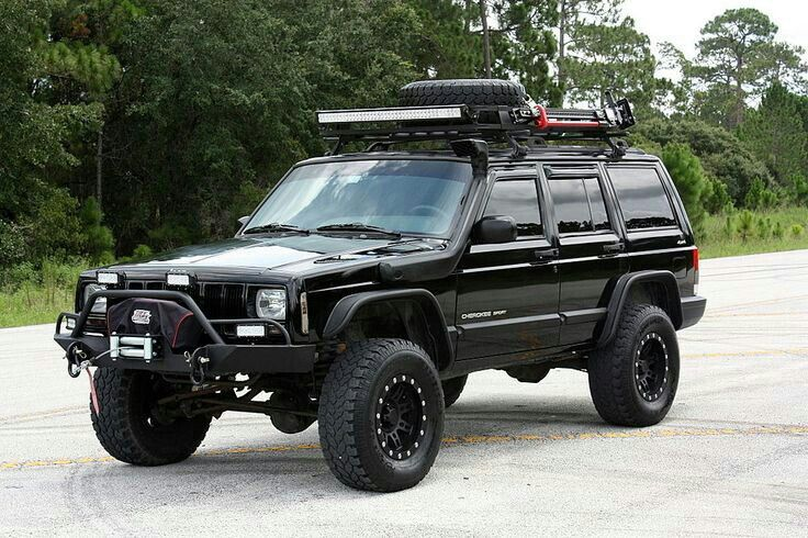 Black fully upgraded custom XJ jeep cherokee