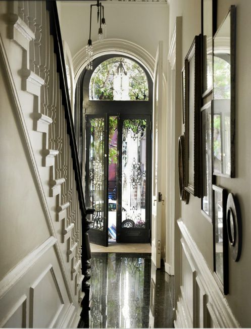 Elegant black and white hallway that gives the home the grandeur thats required