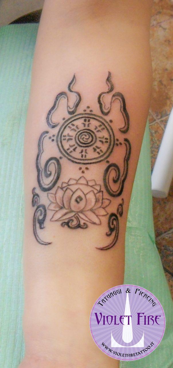 tatuaggio religioso, tatuaggio etnico, tatuaggio piccolo, tatuaggio Fiore Loto + Ruota dell'esistenza buddista su braccio - Violet Fire Tattoo - tatuaggi maranello, tatuaggi modena, tatuaggi sassuolo, tatuaggi fiorano - Adam Raia