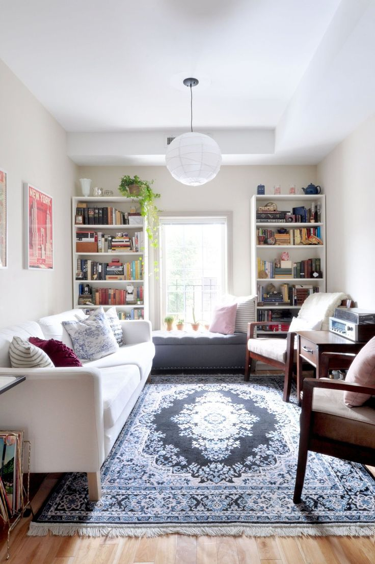 like the way this narrow room is set up - especially the rug and the  bookshelves
