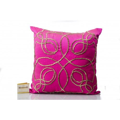 This Fushia Silk Cushion Cover with cut dana work in gold color, features back zip; comes with compress poly filler.  http://handmadeworld.in/handmade-home-furnishing/fushia-abstract-hand-beaded-cushion-filler.html