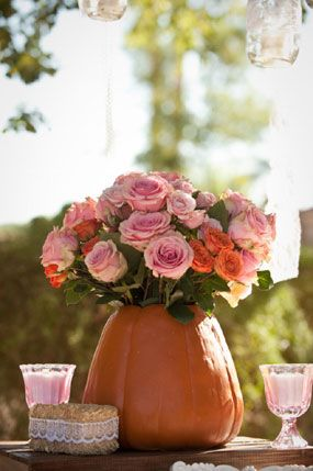 roses and pumpkin pink and orange first birthday party farm flower centerpiece in a pumpkin