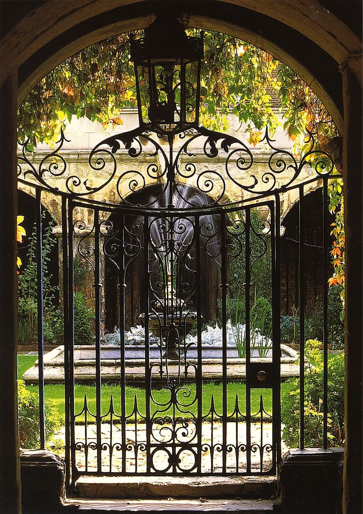 The iron gate and entrance to the Small Cloister at Westminster Abbey. London.