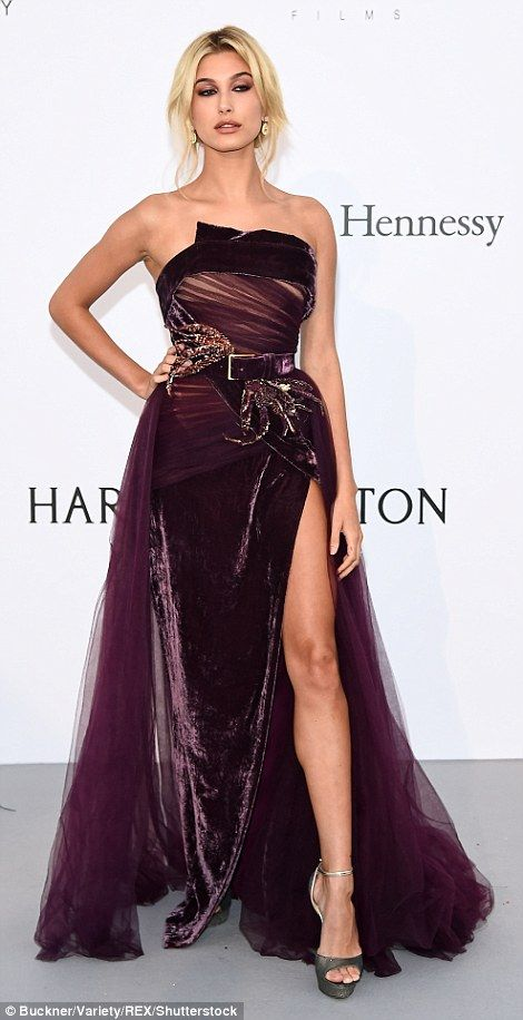 2017 70th CANNES Film Festival AMFAR GALA  HAILEY BALDWIN Pretty as a plum: Her designer garment featured a thigh-high slit that showcased her honed...