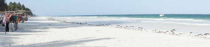 Kikoy, worn on beaches caressed by sea breezes, the sarong becomes even more authentic ~~ Nelle spiagge della costa, consumati dalla brezza marina, i parei sono ancora più originali