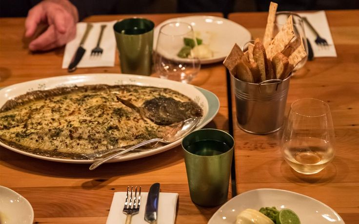 Roasted turbot with wasabi custard and olive and lime tapenade and flatbreads
