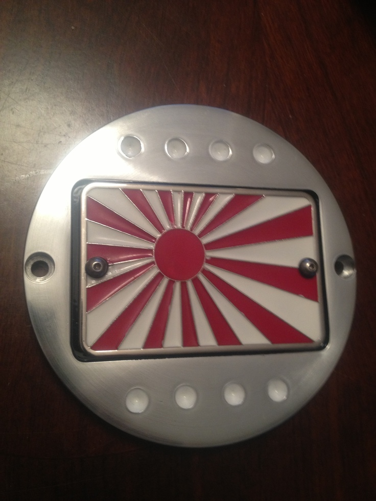 Here's a custom machined generator cover I made for my xs650...I used a Japanese flag belt buckle for the emblem...