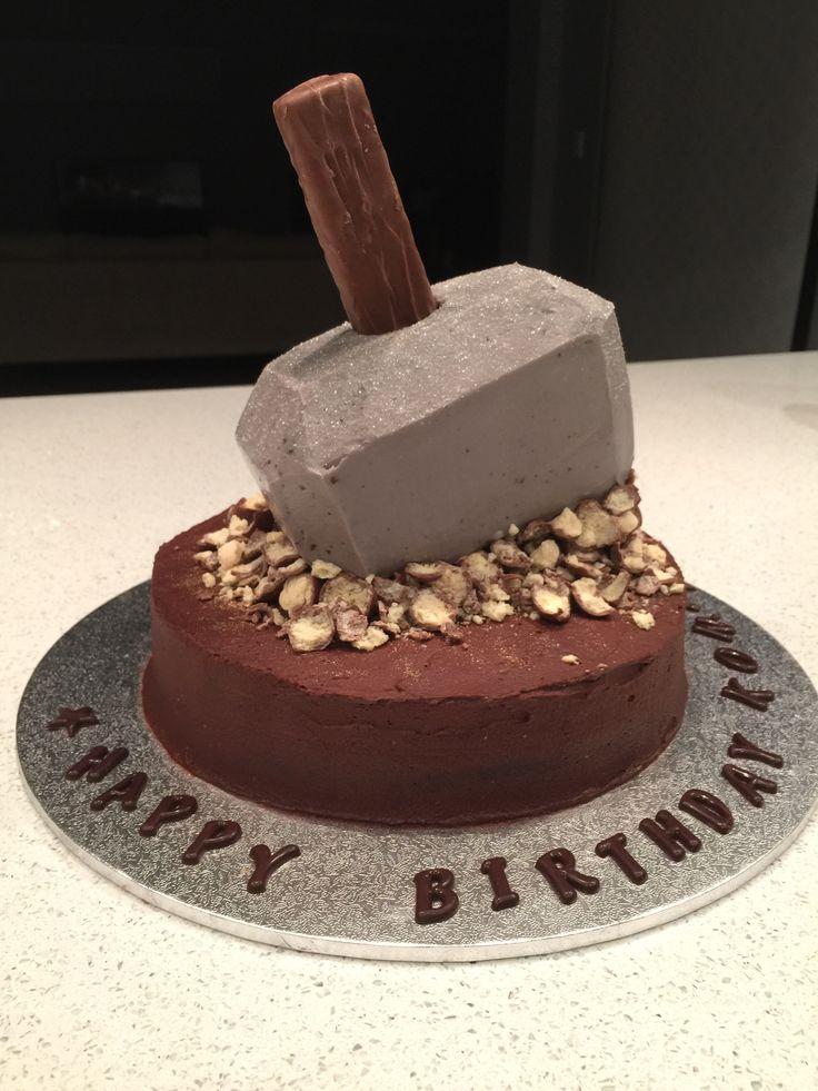 Thor's Mjolnir cake. Base: mud cake with chocolate mousse. Hammer: mud cake with cream cheese icing + Mars bar
