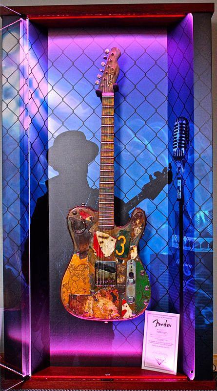 "ZAAX wall guitar display ""Rythm ... Rock, Jazz, Blues"" and Fender Masterbuilder Dave Newman"