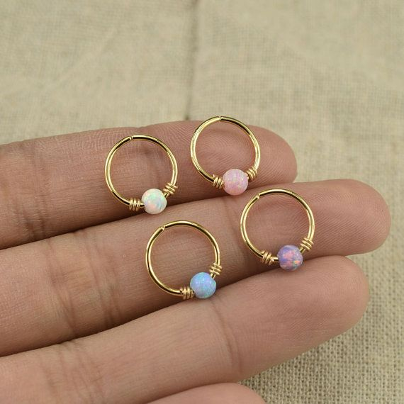 This listing is for one opal cartilage tragus helix earring. The hoop has 16g(1.2mm)/18g(1.0mm)/20g(0.8mm) for your choise and the inner