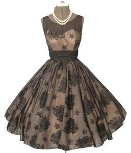 1950 cocktail dress features flocking and glitter
