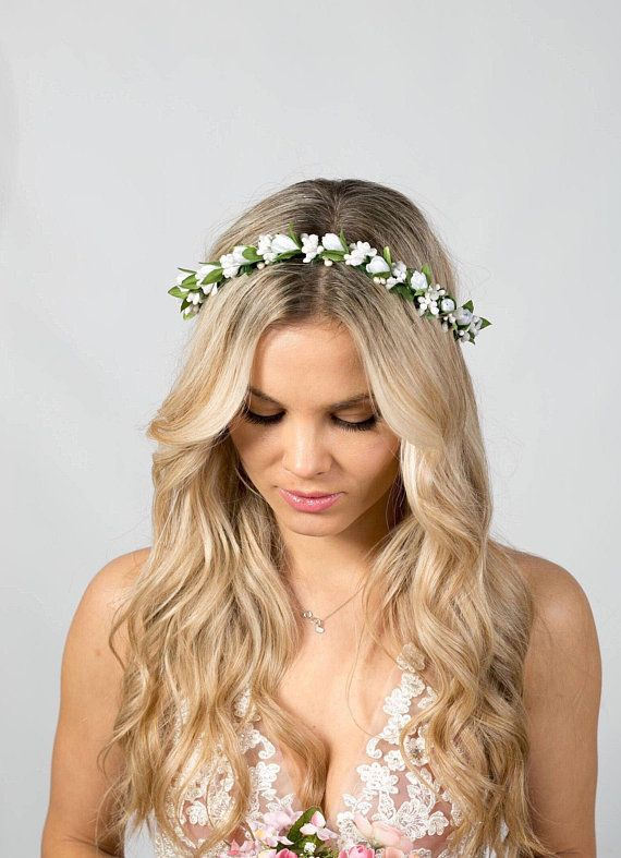 Beautiful and elegant floral crown with white flowers that makes a perfect finis…
