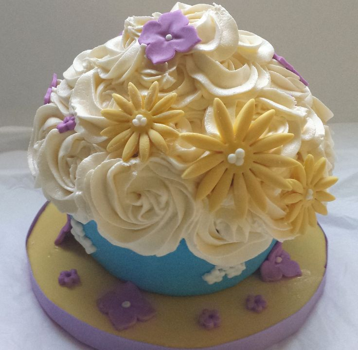 Giant Cupcake with  fondant designs and buttercream flowers