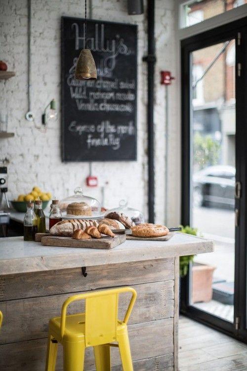 dustjacketattic:  wood counter & yellow tolix stool | photo helen cathcart