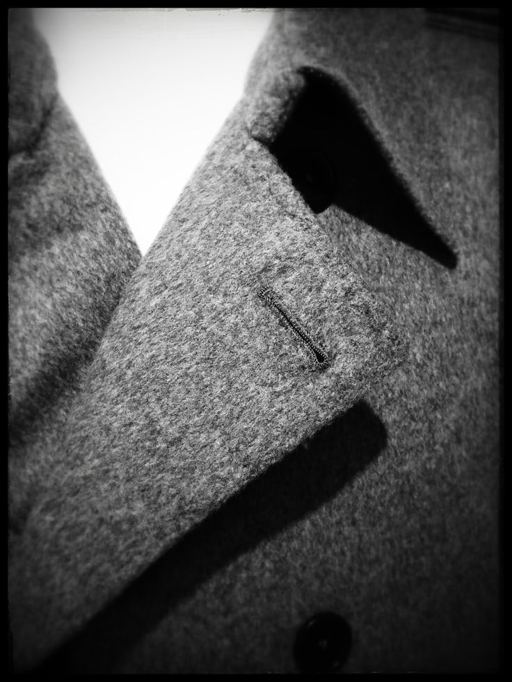 handmade button hole on a cashmere trench coat