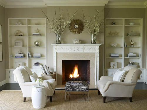 Love the couches and fire place, but those shelves need lots and lots of books organized by color!