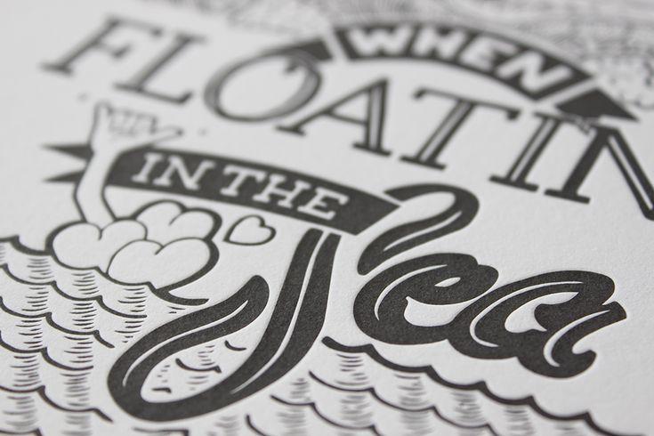A close up of the Help Save Elke letterpress prints.