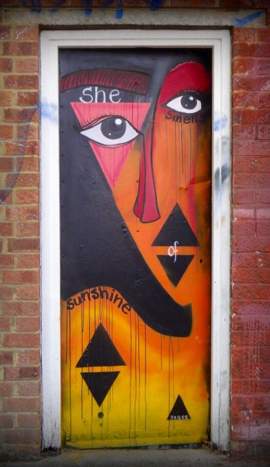 'She smells of sunshine' painted door in Shoreditch, London, England